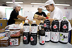 Yagisawa Shoten staff package boxes with products now made under license by other companies at the soy sauce and miso maker's temporary premises in Ichinoseki, Iwate Prefecture Prefecture, Japan on 04 Sept. 2011. Photograph: Robert Gilhooly
