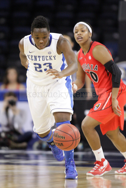 UK forward Samarie Walker steals the ball from Georgia during the second half of the University of Kentucky women's basketball game vs. the University of Georgia during the SEC Tournament at The Arena at Gwinnett Center in Duluth, Ga., on Saturday, March 9, 2013. UK won 60-38. Photo by Tessa Lighty | Staff