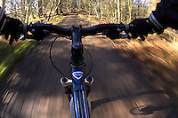 riders eye view of trail and bike handlebars.virginia Water Surrey January 2008.pic copyright Steve Behr / Stockfile