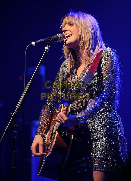 GRACE POTTER of Grace Potter and The Nocturnals .performs live at The El Rey Theatre in Los Angeles, California, USA, .February 4th 2011..music concert gig on stage half length beaded  mini dress black silver  microphone   singing playing guitar side                                                        .CAP/RKE/DVS.©DVS/RockinExposures/Capital Pictures.