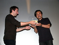 KIYOSHI KUROSAWA at Fantasia Festival<br /> <br /> <br /> Japanese film maker KIYOSHI KUROSAWA (right)  receive a birthday cake from Fantasia Asian section programmer Julien FonfrËde (left)  while  on stage to present his movie S…ANCE at Fantasia Film Festival, July 18 2001 in Montreal, CANADA <br /> <br /> Born in  1955 in  Kobe, He allready made about 30 movies of all kinds  :  horror, erotism, drama, action, Yakuza gangsters. The most famous beeing :<br /> Cure (1997), Barren Illusions (1999) and  Charisma (1999). He is one of the most productive and important film maker in contemporary Japanese cinema.<br /> <br /> Photo by Pierre Roussel / Getty Images News Service<br /> <br /> NOTE :  Nikon D-1 JPEG, opened with QUIMAGE ICC profile, saved as Adobe RG 1998