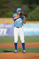 Burlington Royals starting pitcher Alex Luna (21) looks to his catcher for the sign against the Danville Braves at Burlington Athletic Park on August 13, 2015 in Burlington, North Carolina.  The Braves defeated the Royals 6-3. (Brian Westerholt/Four Seam Images)