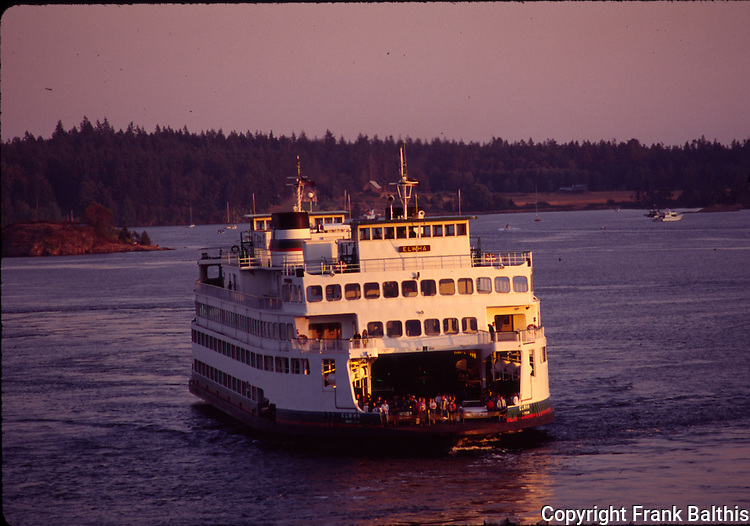 Ferry approaching at sunset to Orcas Island