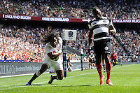 Marland Yarde of England dives over to score a try during the match between England and Barbarians at Twickenham on Sunday 26th May 2013 (Photo by Rob Munro)