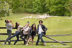 Dancers from Ballet Hispanico, backed by a flock of sheep, relax at the Stone Barns Center for Food and Agriculture...(From left:  Donald Borror, Melissa Fernandez, Kimberly Van Woesik, Michele Manzanales (rehearsal director),  and Joshua Winzeler.)