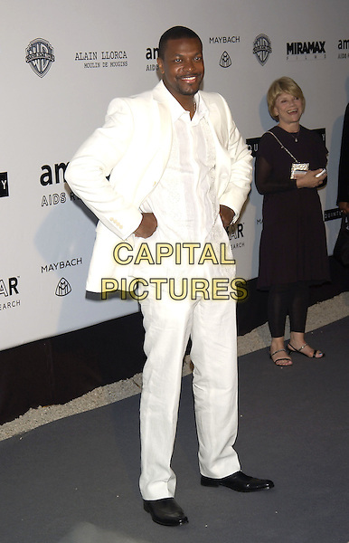 CHRIS TUCKER.arrivals at  amfAR 's Cinema Against Aids 2004.at Le Moulin de Mougins .Cannes Film Festival, France 20 May 2004..full length white suit shirt.sales@capitalpictures.com.www.capitalpictures.com.©Capital Pictures