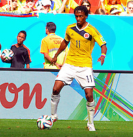 BRASILIA - BRASIL -19-06-2014. Juan Cuadrado jugador de Colombia (COL) en acción durante partido del Grupo C contra Costa de Marfil (CIV) por la Copa Mundial de la FIFA Brasil 2014 jugado en el estadio Mané Garricha de Brasilia./ Juan Cuadrado player of Colombia (COL) in action during the macth of the Group C against Costa de Marfil (CIV) for the 2014 FIFA World Cup Brazil played at Mane Garricha stadium in Brasilia. Photo: VizzorImage / Alfredo Gutiérrez / Contribuidor