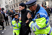 Police arrest a demonstrator outside the Bank of England as thousands of protestors descended on the City of London ahead of the G20 summit of world leaders to express anger at the economic crisis, which many blame on the excesses of capitalism.