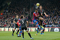 3rd November 2019; Selhurst Park, London, England; English Premier League Football, Crystal Palace versus Leicester City; Jonny Evans of Leicester City heads clear from Jordan Ayew of Crystal Palace - Strictly Editorial Use Only. No use with unauthorized audio, video, data, fixture lists, club/league logos or 'live' services. Online in-match use limited to 120 images, no video emulation. No use in betting, games or single club/league/player publications