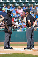 Umpires James Jean (left) and Colin Baron (right) prior to the South Atlantic League game between the Charleston RiverDogs and the Hickory Crawdads at L.P. Frans Stadium on May 13, 2019 in Hickory, North Carolina. The Crawdads defeated the RiverDogs 7-5. (Brian Westerholt/Four Seam Images)