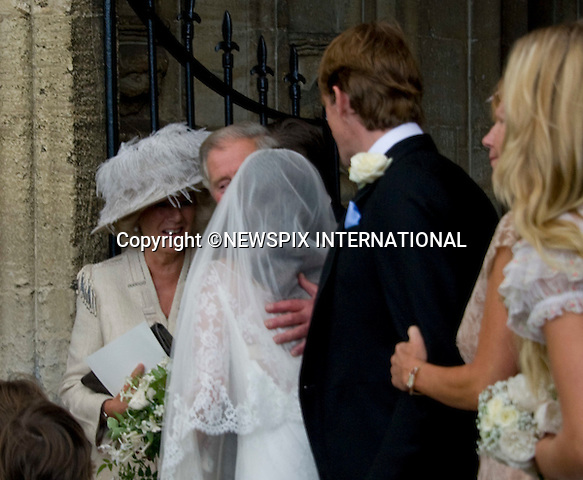 """PRINCE CHARLES KISSES THE BRIDE.BEN ELLIOT AND MARY CLARE WINWOOD WEDDING.Camilla, Duchess of Corwall's nephew Ben Elliot and Mary Clare Winwood daughter of musician Steve Winwood tied the knot at the Church of St Peter & St Paul, Northleach_Gloucestershire_10/09/2011.Mandatory Credit Photo: ©Dias/NEWSPIX INTERNATIONAL..**ALL FEES PAYABLE TO: """"NEWSPIX INTERNATIONAL""""**..IMMEDIATE CONFIRMATION OF USAGE REQUIRED:.Newspix International, 31 Chinnery Hill, Bishop's Stortford, ENGLAND CM23 3PS.Tel:+441279 324672  ; Fax: +441279656877.Mobile:  07775681153.e-mail: info@newspixinternational.co.uk"""