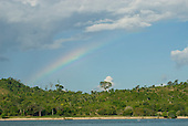 Pará State, Brazil. Xingu River. Rainbow over the forest.