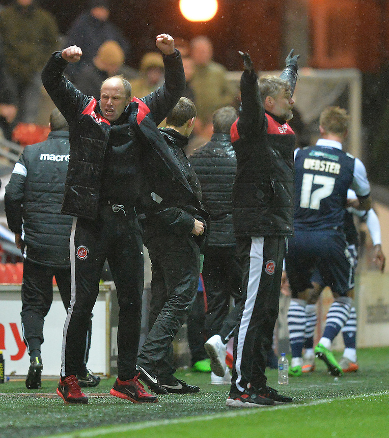 The management celebrate their first back to back home victory<br /> <br /> Photographer Dave Howarth/CameraSport<br /> <br /> Football - The Football League Sky Bet League One - Fleetwood Town v Millwall - Tuesday 24th November 2015 - Highbury Stadium<br /> <br /> &copy; CameraSport - 43 Linden Ave. Countesthorpe. Leicester. England. LE8 5PG - Tel: +44 (0) 116 277 4147 - admin@camerasport.com - www.camerasport.com