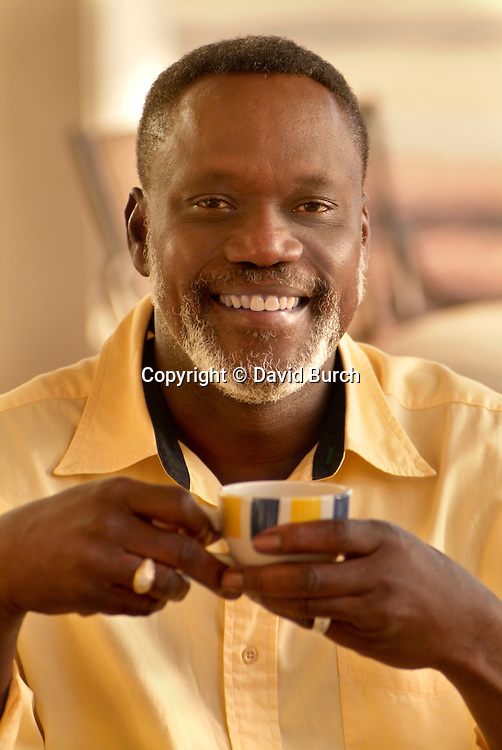 African American man drinking coffee and smiling