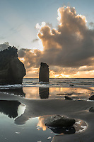 Sunset on coastline at Three Sisters rock formation and Tongaporutu River near Taranaki, New Plymouth, Taranaki Region, North Island, New Zealand, NZ