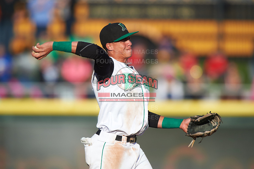 Dayton Dragons shortstop Luis Gonzalez (2) warmup throw to first during a game against the Great Lakes Loons on May 21, 2015 at Fifth Third Field in Dayton, Ohio.  Great Lakes defeated Dayton 4-3.  (Mike Janes/Four Seam Images)