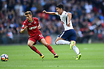 Son Heung-Min of Tottenham Hotspur is challenged by Tom Carroll of Swansea City during the premier league match at the Wembley Stadium, London. Picture date 16th September 2017. Picture credit should read: Robin Parker/Sportimage