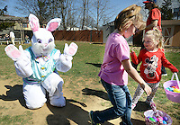 FAIRLESS HILLS, PA - APRIL 12:  The Easter Bunny, portrayed by Diana Nordtveit waves goodbye to Lily Nahill (C), 7 and Alaina Sottile, 4 of Morrisville, Pennsylvania during the YMCA Easter Egg Hunt April 12, 2014 in Fairless Hills Pennsylvania. (Photo by William Thomas Cain/Cain Images)