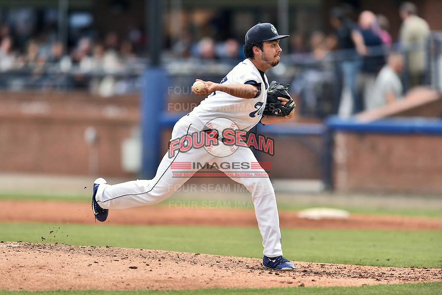 Asheville Tourists pitcher Justin Lawrence (27) delivers a pitch during a game against the Hagerstown Suns at McCormick Field on June 6, 2016 in Asheville, North Carolina. The Tourists defeated the Suns 12-10. (Tony Farlow/Four Seam Images)