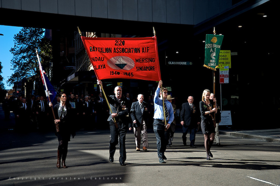 About 20,000 former soldiers, current servicemen and women, police and relatives take part in the march in Sydney CBD.