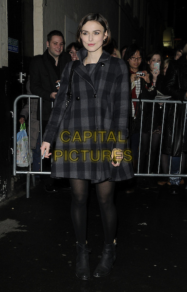 """KEIRA KNIGHTLEY .Departed the evening performance of """"The Children's Hour"""", Comedy Theatre, London, England, UK, March 12th 2011.. full length  grey gray black tights checked check coat plaid ankle boots .CAP/CAN.©Can Nguyen/Capital Pictures."""