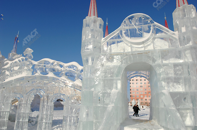 People walked past ice sculptures in the centre of the city of Novy Urengoy, the base for Gazprom's operations in the surrounding area, Yamal-Nenets Autonomous District, Russia, February 29, 2008