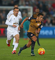 Leon Britton of Swansea City and Alexis Sanchez of Arsenal during the Barclays Premier League match between Swansea City and Arsenal played at The Liberty Stadium, Swansea on October 31st 2015