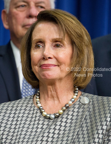 United States House Minority Leader Nancy Pelosi (Democrat of California) looks on as US President Barack Obama makes remarks prior to signing H.R. 2576, the Frank R. Lautenberg Chemical Safety for the 21st Century Act in the South Court Auditorium of the White House in Washington, DC on Wednesday, June 22, 2016. The bill will establish standards for the use of certain toxic chemicals used regularly.<br /> Credit: Ron Sachs / CNP