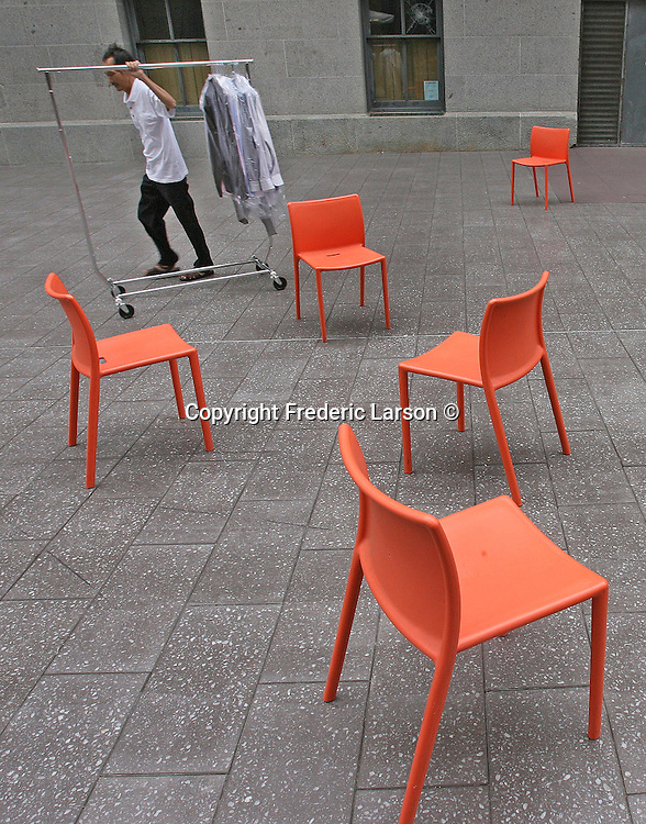 Chairs placed in a courtyard near the Mint at 5th and Mission Street in San Francisco, California.