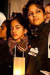 Two participants at the candle light vigil held at the Bella Center. (Credit: Robert vanWaarden/Avaaz.org)