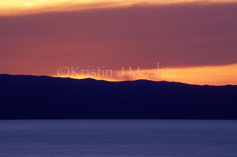 After sunset view across Lake Tanganyika to Congo. Gombe National Park, Tanzania