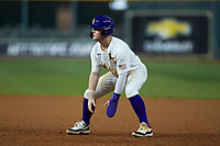 Daniel Cabrera (8) of the LSU Tigers takes his lead off of first base against the Texas Longhorns in game three of the 2020 Shriners Hospitals for Children College Classic at Minute Maid Park on February 28, 2020 in Houston, Texas. The Tigers defeated the Longhorns 4-3. (Brian Westerholt/Four Seam Images)