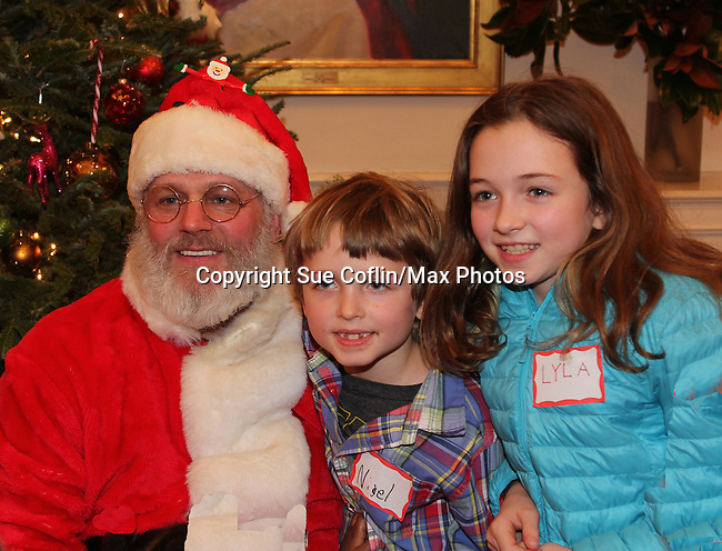 Santa Claus with Another World's and Blue Bloods Amy Carlson' daughter Lyla - son Nigel - Hearts of Gold links to a better life celebrates Christmas with a party #3 for mothers and their children on December 22, 2016 in New York City, New York with arts and crafts, a great turkey dinner with all the goodies and then the children met Santa Claus and had a photo with him as he gave them gifts. (Photo by Sue Coflin/Max Photos)
