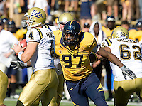 Cameron Jordan of California tries to sack UCLA quarterback Kevin Prince during the game at Memorial Stadium in Berkeley, California on October 9th, 2010.   California defeated UCLA, 35-7.