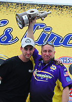 May 1, 2011; Baytown, TX, USA: NHRA pro stock driver Vincent Nobile (left) celebrates with father John Nobile after winning the Spring Nationals at Royal Purple Raceway. Mandatory Credit: Mark J. Rebilas-