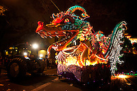 Leviathan, the dragon float, complete with fiber optics and blowing smoke is one the largest floats in the Krewe of Orpheus parade as it rolls on the day before Mardi Gras through the Uptown area of New Orleans, Louisiana, USA.
