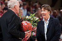 STANFORD, CA - January 8, 2011: President John Hennessy and Coach Tara VanDerveer of the Stanford Cardinal women's basketball team during VanDerveer's 800th career win celebration after Stanford's game against Arizona State at Maples Pavilion. Stanford won 82-35.