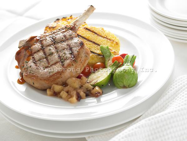 Pork chop with polenta cakes, vegetables