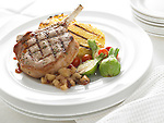 Pork chop with polenta cakes, vegetables