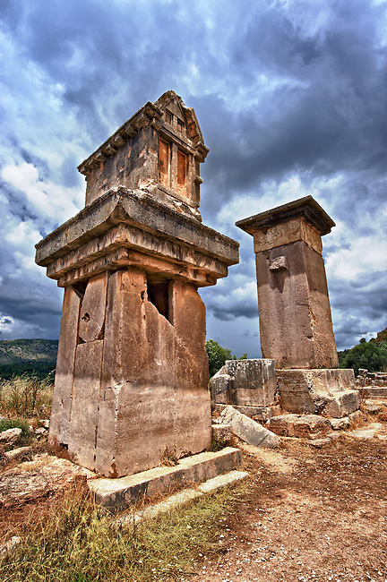"""The Lycian """"Harpy Tomb"""", a marble pillar tomb from 480-470 B.C. The the Greek Archaic style carvings of four winged female figures, Harpies"""" that covered the tomb were removed by Charles Fellows and are now in the British Museum.  Xanthos UNESCO World Heritage Archaeological Site, Turkey"""