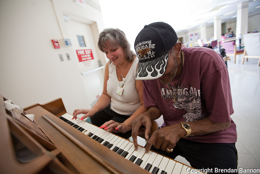 Director of nursing, Kate Wannemacher and Boyd Lee Dunlop play piano together at Delaware Nurising and Rehab, The Buffalo, NY  nursing home where Dunlop has lived for several years.