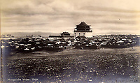 BNPS.co.uk (01202 558833)<br /> Pic: ClevedonAuctionRooms/BNPS<br /> <br /> Urga in Mongolia (now Ulam Bator).<br /> <br /> Rev Francis John Griffith travelled as a Missionary aroud Outer Mongolia in the 1920's.<br /> <br /> A fascinating collection of early 20th century photos of Mongolia and China which were taken by a British vicar doing missionary work have been unearthed after 97 years.<br /> <br /> Through his famine relief work Reverend Francis John Griffith was able to get a remarkable insight into the lives of the native population and their nomadic existence.<br /> <br /> His encounters were captured using a handheld camera that he carried with him at all times.<br /> <br /> In one image a family goes about its business outside the hut that is their home, while another image is of a man riding a camel which was the typical method of transport.<br /> <br /> Revd Griffith was able to get native elders to sit for him in portraits and there are intimate snaps of women and children wearing elaborate native headdresses.<br /> <br /> As well as the people, Revd Griffith took an interest in the surroundings and photographed temples and prominent buildings in addition to the vast, desert landscape.