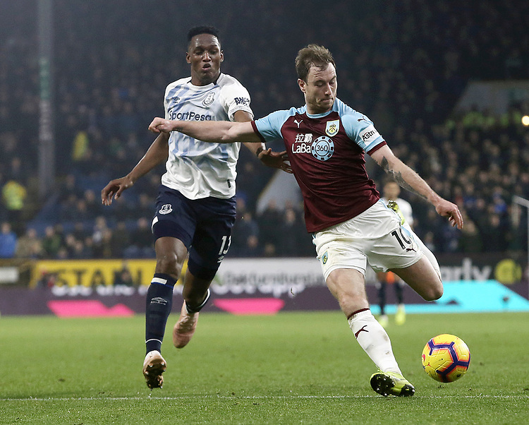 Burnley's Ashley Barnes under pressure from Everton's Yerry Mina<br /> <br /> Photographer Rich Linley/CameraSport<br /> <br /> The Premier League - Burnley v Everton - Wednesday 26th December 2018 - Turf Moor - Burnley<br /> <br /> World Copyright © 2018 CameraSport. All rights reserved. 43 Linden Ave. Countesthorpe. Leicester. England. LE8 5PG - Tel: +44 (0) 116 277 4147 - admin@camerasport.com - www.camerasport.com