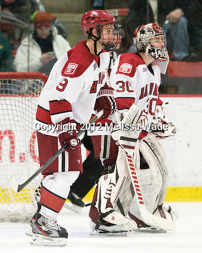 Danny Biega (Harvard - 9), Raphael Girard (Harvard - 30) - The Harvard University Crimson defeated the visiting Clarkson University Golden Knights 3-2 on Harvard's senior night on Saturday, February 25, 2012, at Bright Hockey Center in Cambridge, Massachusetts.