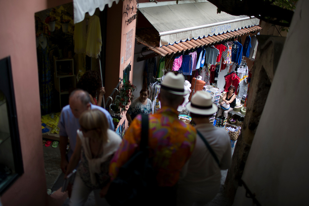 People make their way through a narrow walkway on Sunday, Sept. 20, 2015, in Positano, Italy. (Photo by James Brosher)