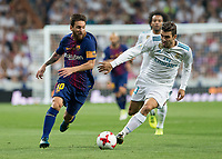 FC Barcelona´s Argentinean forward Lionel Messi and Real Madrid's Austrian midfielder Kovacic
