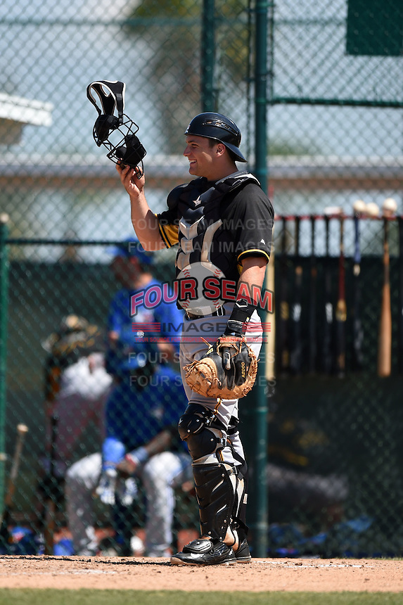 Pittsburgh Pirates catcher Taylor Gushue (18) during a minor league spring training game against the Toronto Blue Jays on March 21, 2015 at Pirate City in Bradenton, Florida.  (Mike Janes/Four Seam Images)