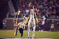 September 7, 2009:    Florida State mascot Chief Osceola throws his flaming spear on the field prior to the start of Atlantic Coast Conference action between the Miami Hurricanes and Florida State Seminoles at Doak Campbell Stadium in Tallahassee, Florida.   Miami defeated Florida State 38-34.