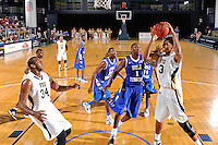 12 January 2012:  FIU guard-forward Dominique Ferguson (3) is fouled by Middle Tennessee center LaRon Dendy (1) while pulling in a rebound in the second half as the Middle Tennessee State University Blue Raiders defeated the FIU Golden Panthers, 70-59, at the U.S. Century Bank Arena in Miami, Florida.
