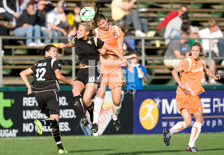 03 May 2009: Leslie Osborne of the FC Gold Pride battles for the ball in the air against Yael Averbuch of the Sky Blue during the game at Buck Shaw Stadium in Santa Clara, California.   FC Gold Pride defeated Sky Blue FC, 1-0.